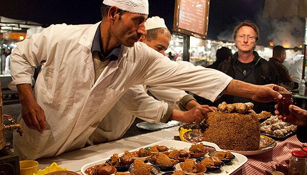 Vendor selling tea in a Marrakesh market