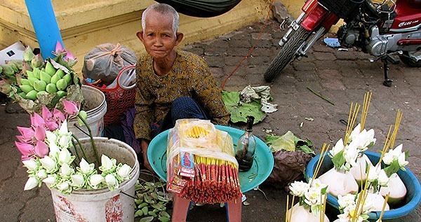A flower seller in a Siam Reap market