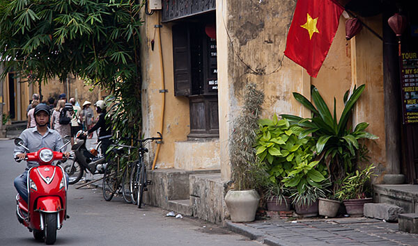 Red motorcycle and flag in Vietnam