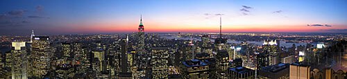 A panorama over New York City at night.