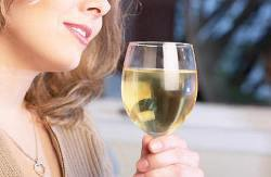 Having a glass of white wine