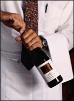 Uncorking a bottle of wine