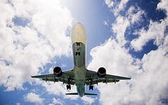 Airplane against a blue sky - photo by matt.hintsa