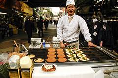 Okonomiyaki chef at his frying table