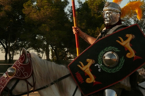 Roman centurion with mask riding a horse