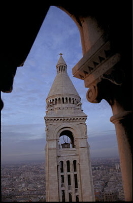 The Sacre Coeur belltower as seen from the main spire. Paris, France.