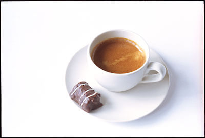 Cup of espresso with M&S chocolate.