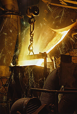 Molten iron pouring into holding vessel in Swedish foundry.
