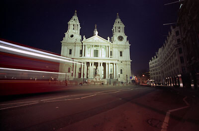 St. Paul's Cathedral, nightshot from Ludgate Hill with a bus passing by.