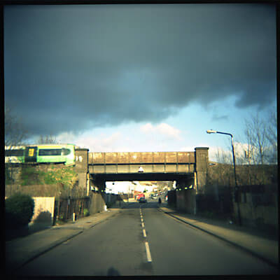 Train going over a bridge. London, England. Shot with Holga.