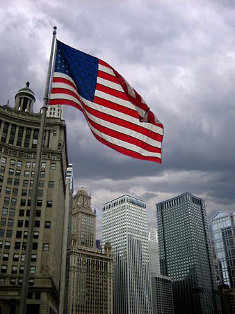 A US flag waving on a windy Chicago day. Looking over the Chicago River towards East Wacker Drive.
