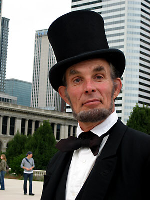 In Millenium Park, this Abraham Lincoln impersonator posed for photos for tourists.