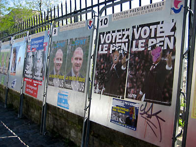 A row of political posters de-faced before the French election. Paris.