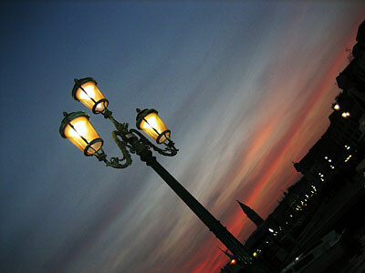 A streetlamp in Venice, Italy, at dusk. The glow is from the pink glass in the lamp.