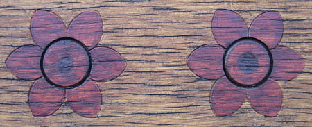 Pretty flower detail on a park bench.