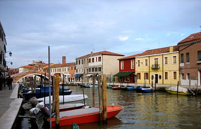 A canal in Murano near Venice, Italy. I love the colorful houses and the water.