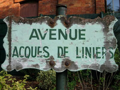 This old weathered sign for Avenue Jacques de Liniers was next to the exit in the Buttes Chaumont park in Paris.