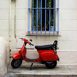 Walking around, I came across this old red scooter in a Marseille square.