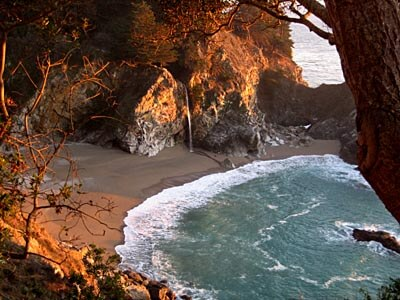 View down over the beautiful McWay Falls in Big Sur at sunset.