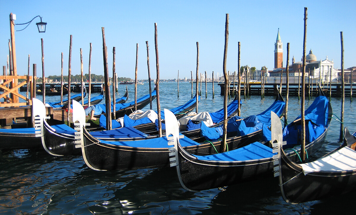 A row of gondolas on the Piazza San Marco pier in Venice, Italy.