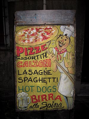 Curious sign for a pizza restaurant in Pisa, Italy.
