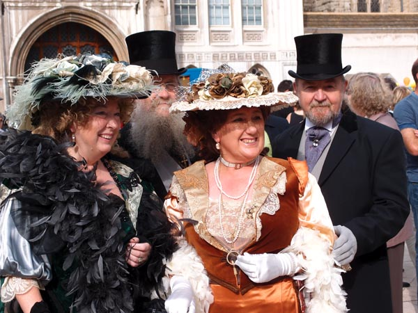 Two ladies and a gentleman at the 2011 Costermongers Festival in London.