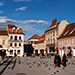 The picturesque Sfatului Square in Brasov, ringed by gothic buildings