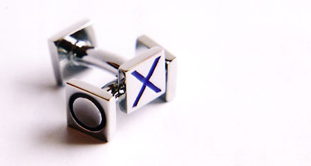 Metal cufflinks. Photographed with natural light from a window and a closeup lens. Used my Canon EOS5 SLR.