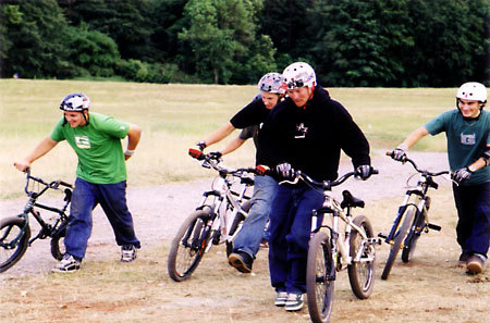 At the Bristol Bike Fest 2004 there was a dirt jump show and these guys are the showmen. They did put up a pretty good set of BMX and mountain bike tricks and dirt jumps.